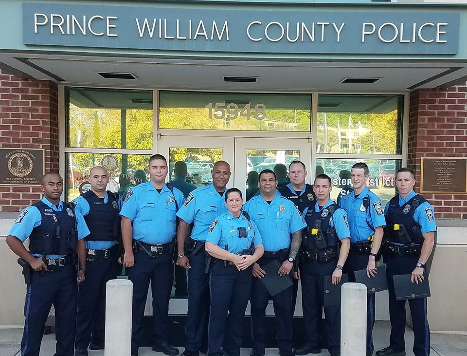 Prince William police stand in front of their station