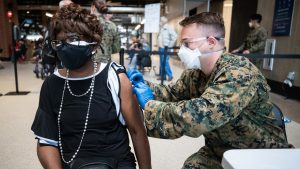 Doris Jackson gets vaccinated at a COVID-19 vaccination site Friday, Feb. 26, 2021, at Globe Life Field in Arlington. The site is a partnership with city, state and federal emergency management agencies. Officials will aim to vaccinate around 3,000 per day.