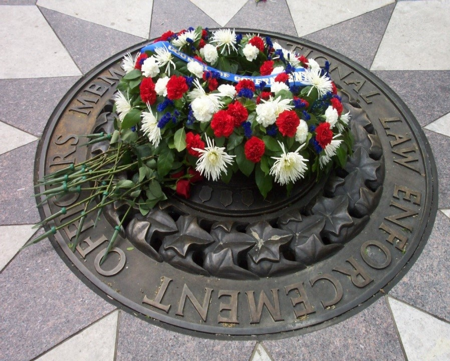 Fallen Officers Memorial with flowers